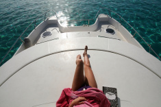 stock-photo-2475134-woman-lying-on-a-boat