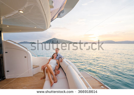 stock-photo-romantic-vacation-and-luxury-travel-young-loving-couple-sitting-on-the-sofa-on-the-modern-yacht-366918614