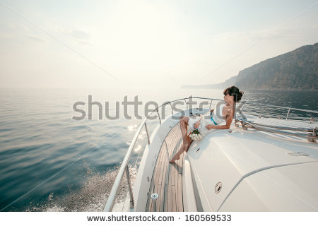 stock-photo-woman-lies-on-a-luxury-yacht-in-the-sea-and-looking-to-the-horizon-160569533